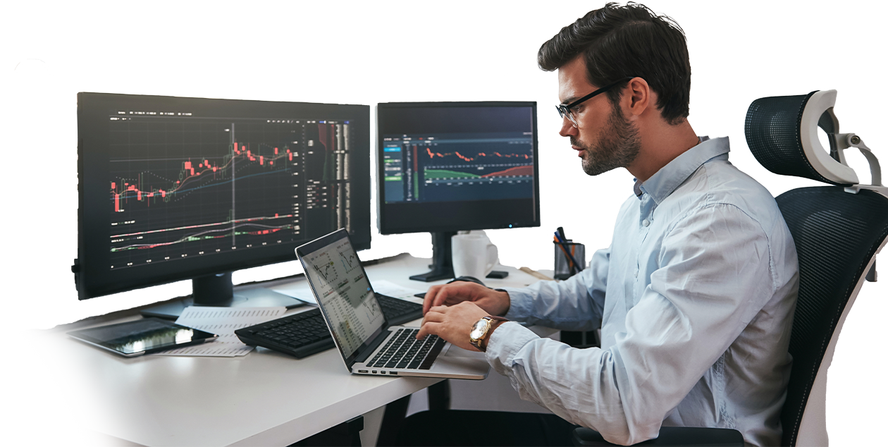 Man working at computer with trading chart